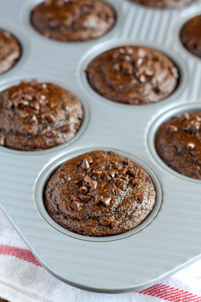 Healthy double chocolate chip muffins in a muffin tin.