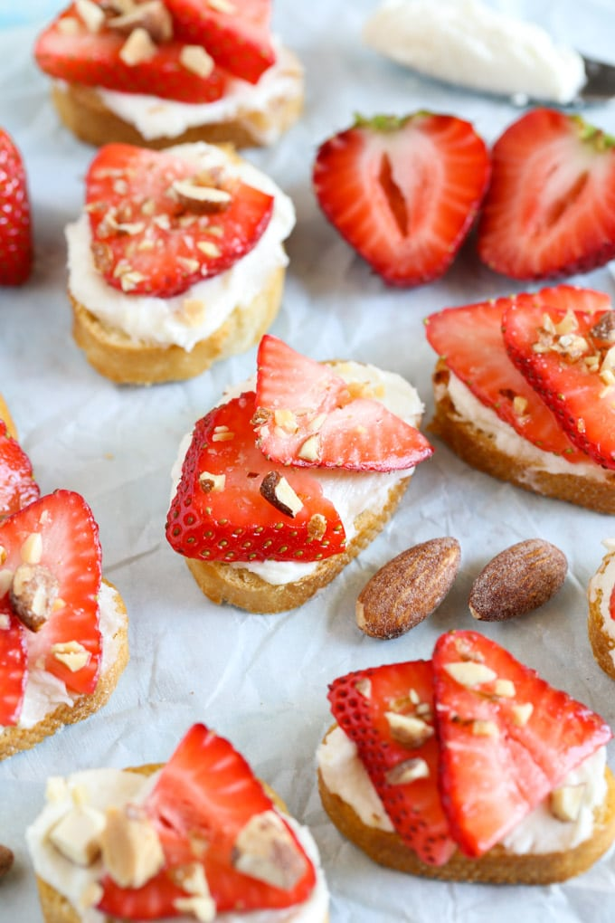 These Strawberry, Almond, and Whipped Honey Goat Cheese Crostini are so easy to make and perfect for summer entertaining!