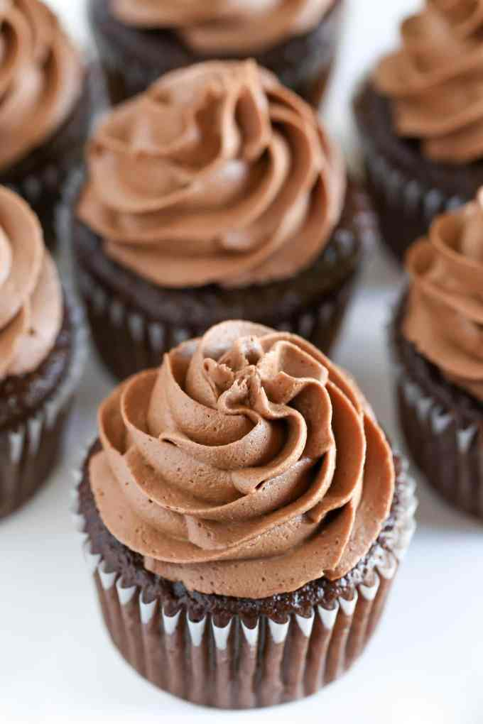 Perfect Chocolate Cupcakes topped with a chocolate buttercream frosting! These cupcakes are easy to make, incredibly soft, light, and moist.