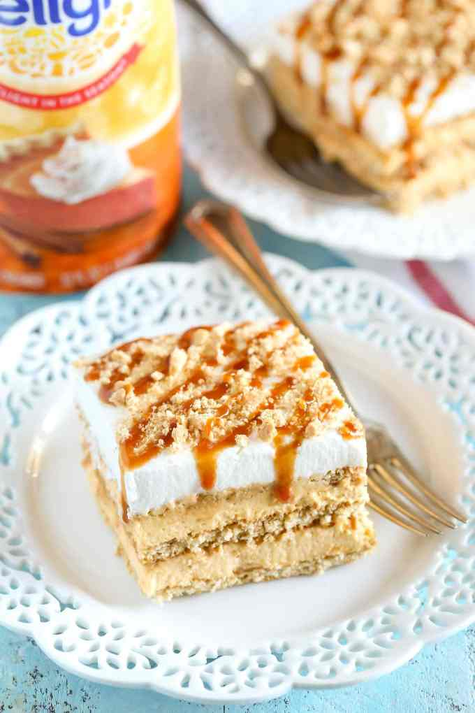 Layers of graham crackers, no-bake pumpkin spice cheesecake filling, and caramel topped off with homemade whipped cream. This No-Bake Pumpkin Caramel Icebox Cake is an easy and delicious fall dessert!