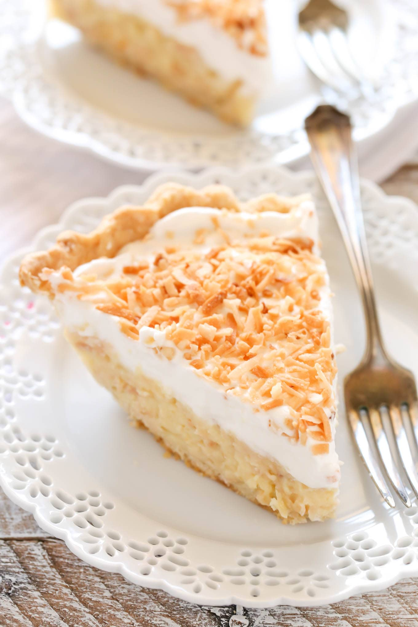 A homemade pie crust filled with a creamy coconut filling and topped with fresh whipped cream and toasted coconut. This homemade coconut cream pie recipe is so easy to make and delicious!