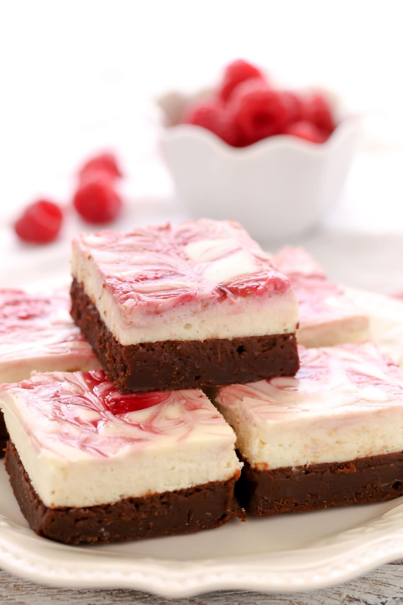 A fudgy brownie base topped with a smooth and creamy cheesecake layer and a raspberry swirl. These Raspberry Cheesecake Brownies make a beautiful dessert for any occasion!