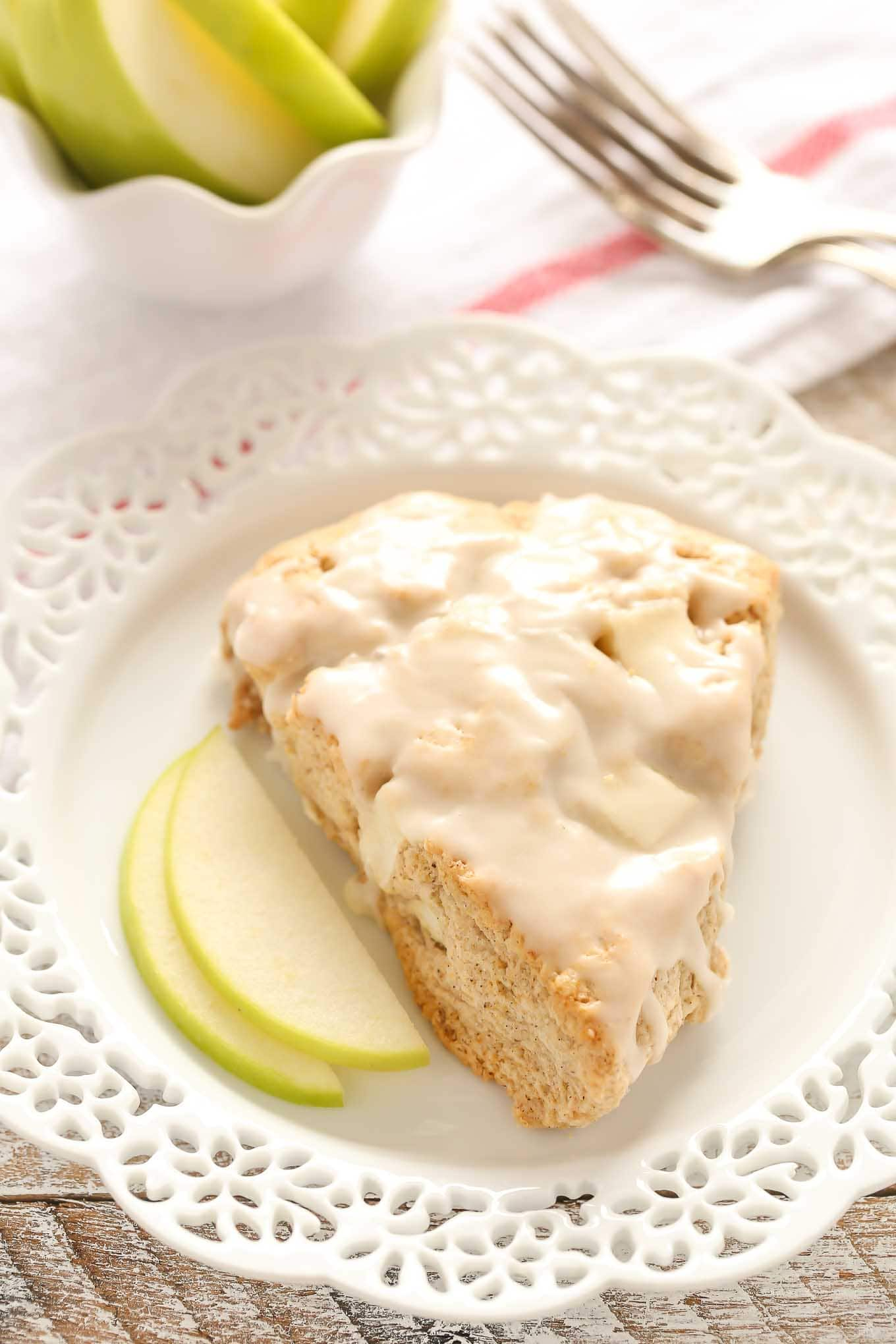 These Apple Cinnamon Scones are filled with chopped apple, spices, and incredibly soft and tender. The perfect treat for breakfast or brunch!