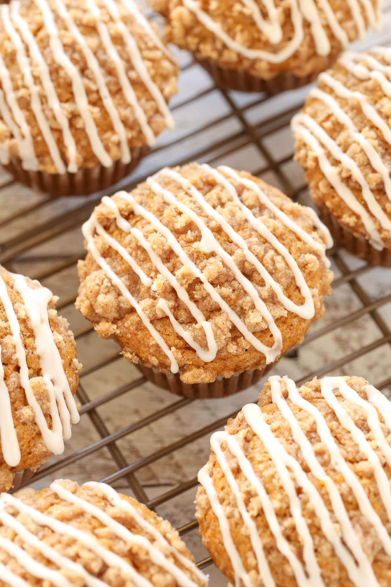 An easy recipe for pumpkin muffins with a crumb topping and vanilla glaze. These pumpkin crumb muffins are perfect for a fall breakfast or dessert!