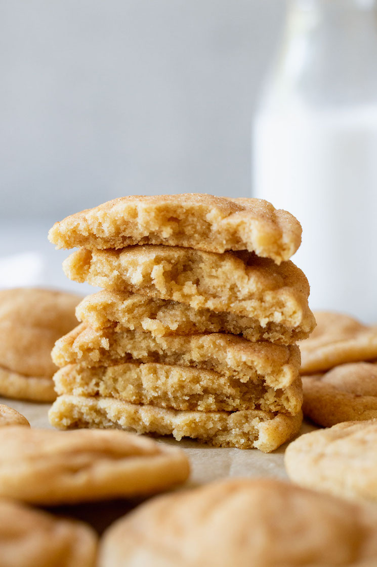 A stack of snickerdoodle cookies broken in half to show the interior texture.