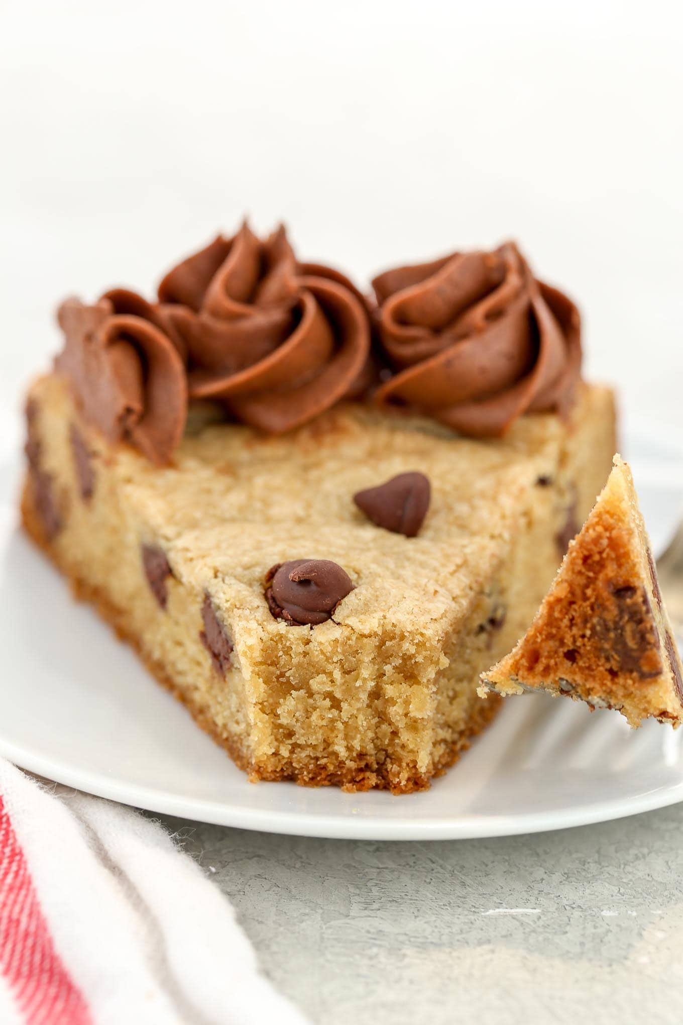 A soft, chewy cookie cake filled with chocolate chips and topped with a chocolate buttercream frosting. This Chocolate Chip Cookie Cake is the perfect dessert for any occasion!