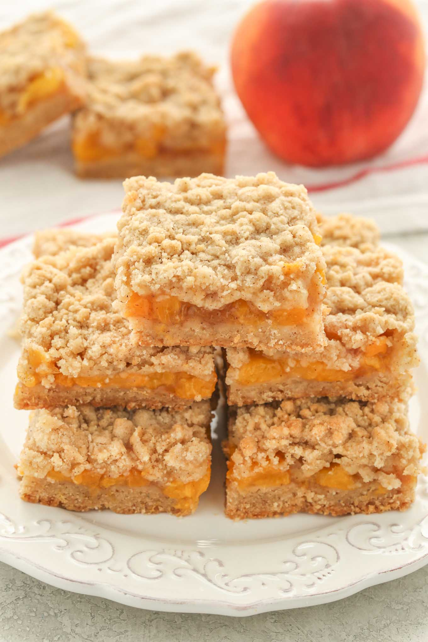 These Peach Crumb Bars use the same buttery crumb mixture for the crust and topping and are filled with an easy peach filling!