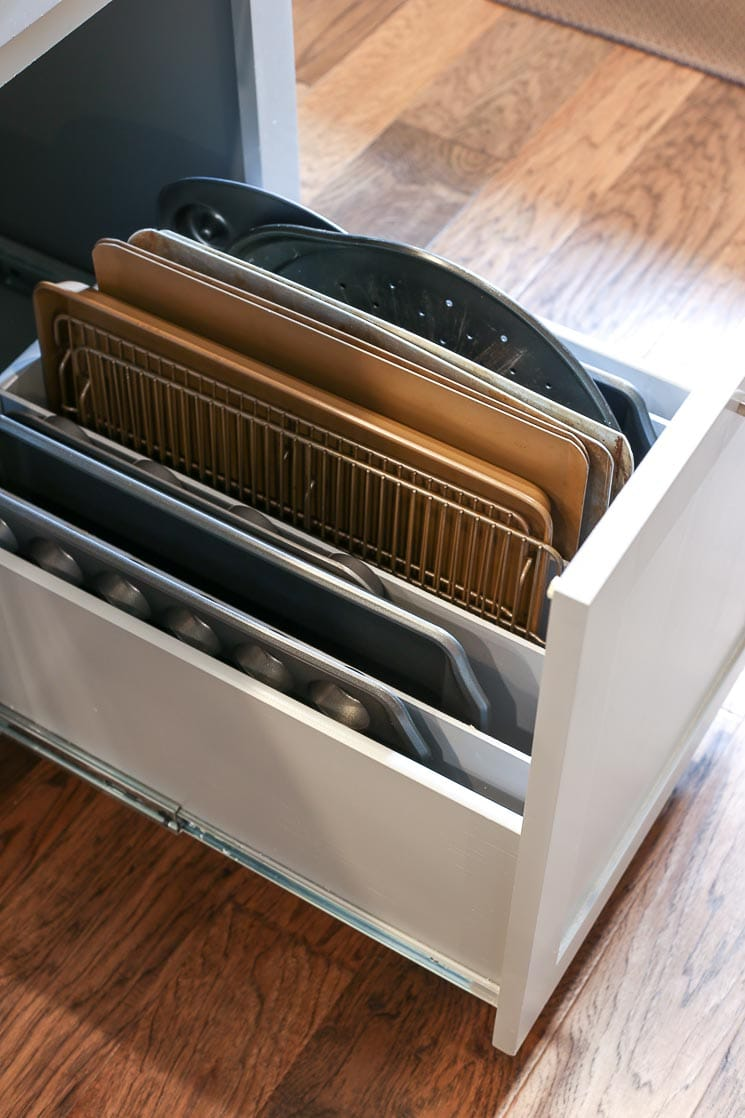 A picture of a drawer with dividers for baking pans and sheets.