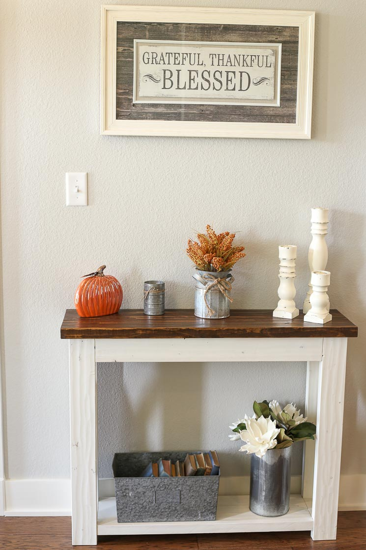 A picture of a farmhouse entry table in an entry way.