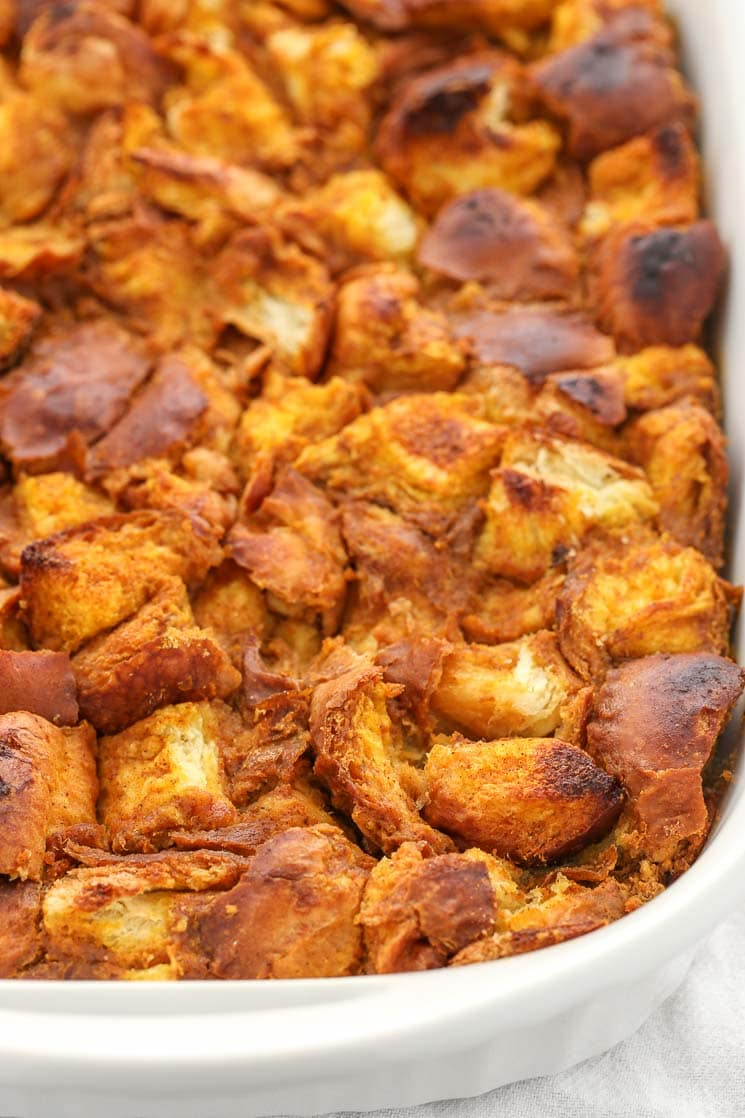 This pumpkin bread pudding is made with pumpkin puree, challah bread, and other simple ingredients. The perfect easy dessert for fall!