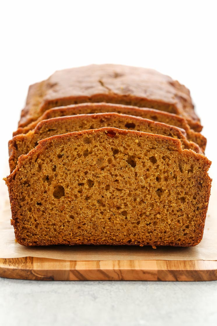 An up-close picture of a loaf of sliced pumpkin bread.