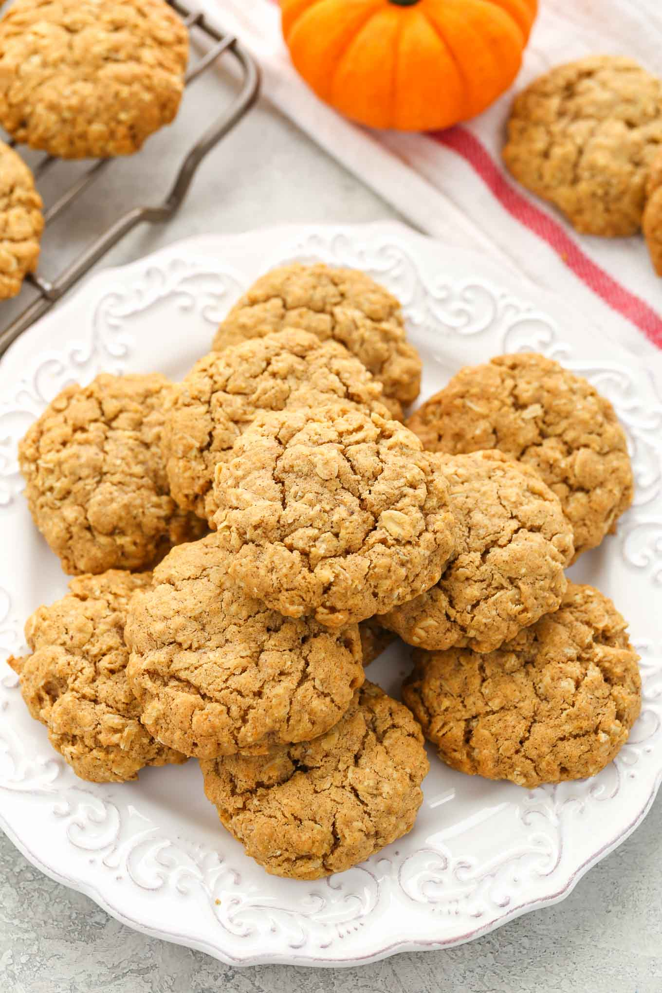 These pumpkin oatmeal cookies are super soft, chewy, thick, and full of pumpkin flavor! The perfect cookie for fall!