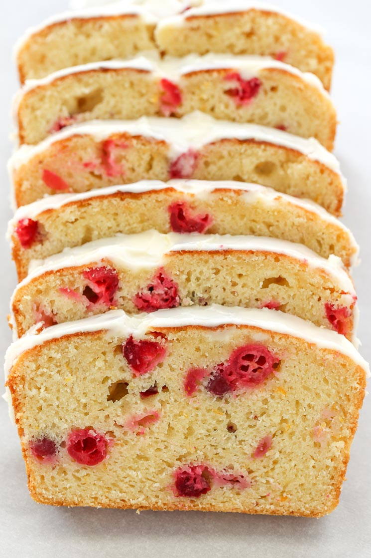 This Cranberry Orange Bread is easy to make, super moist, and topped with a delicious orange glaze. Perfect for breakfast or dessert!