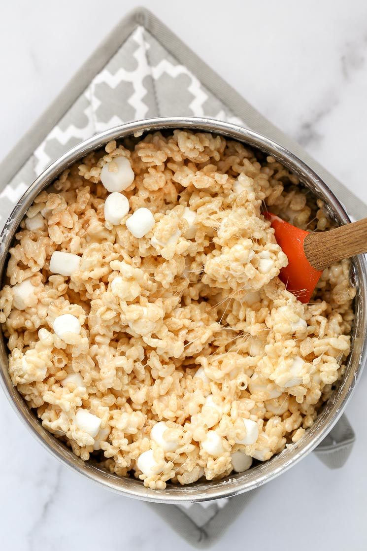 A metal saucepan filled with the rice krispie treat mixture.