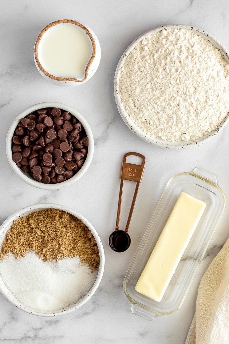 The ingredients for edible cookie dough on a marble surface.