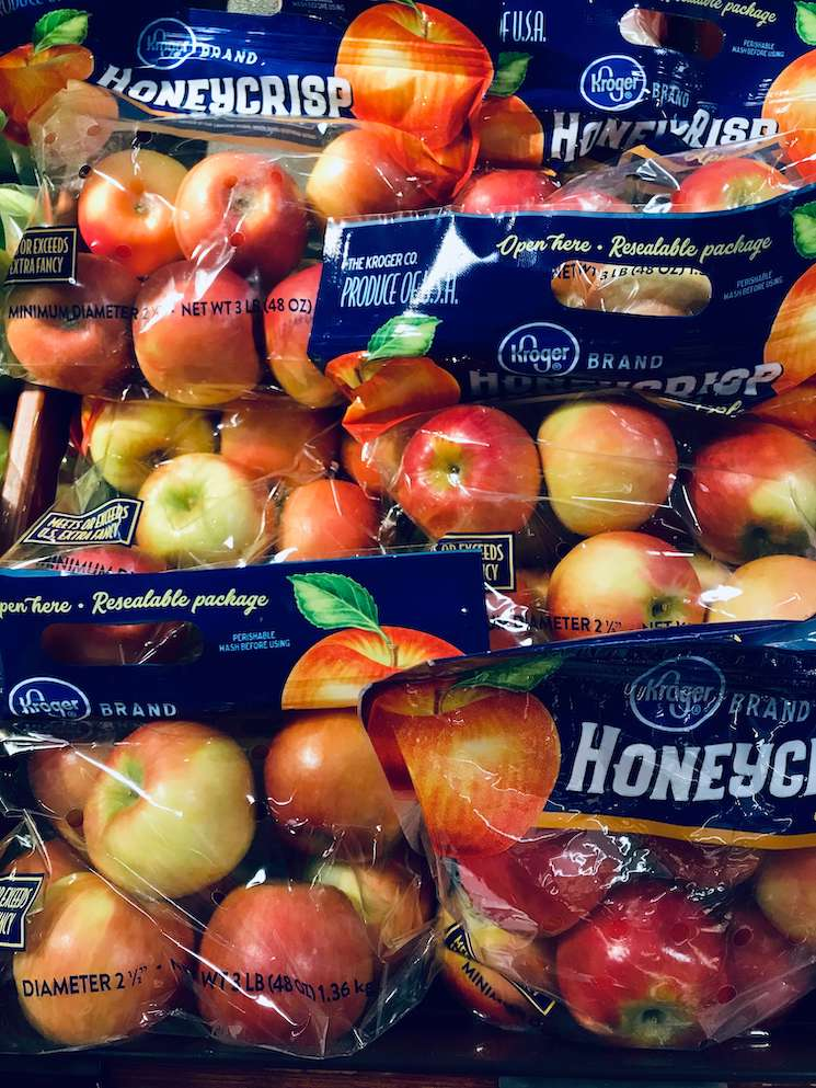 A picture of bags of Honeycrisp apples.