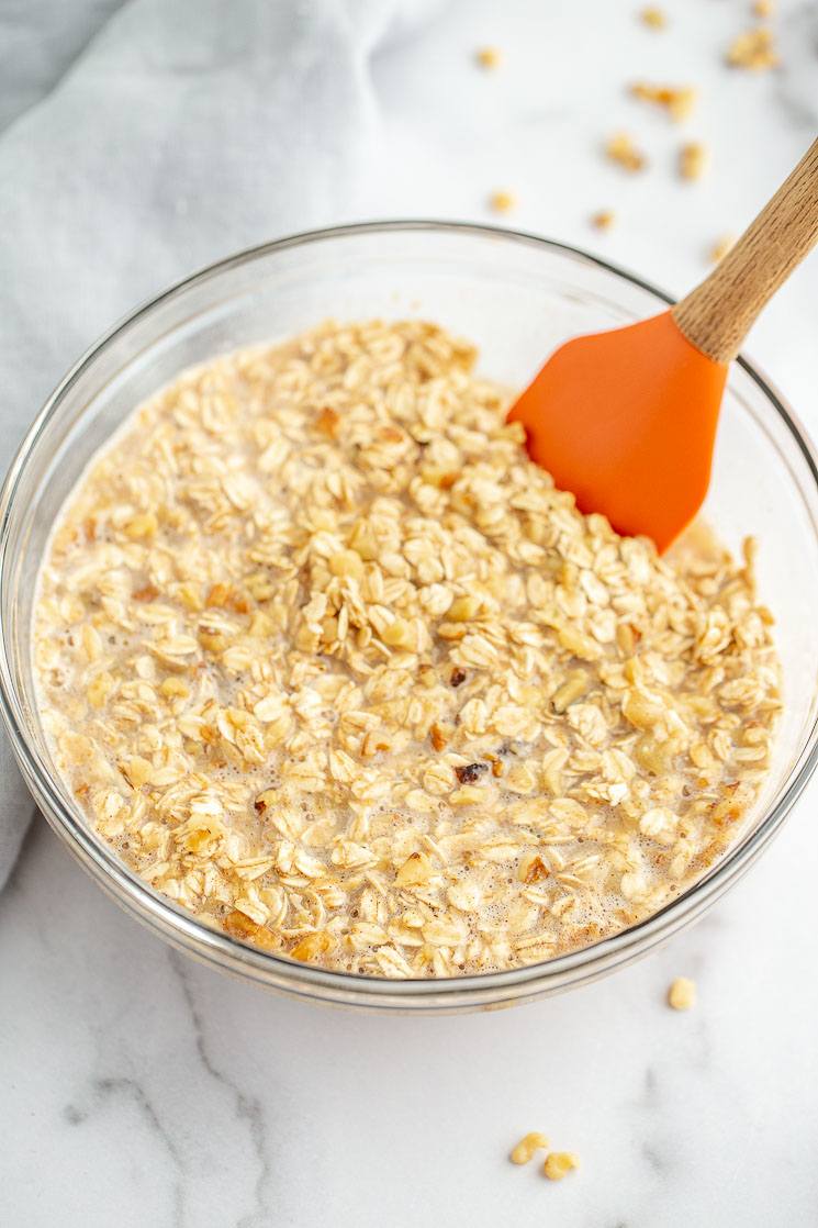 A glass mixing bowl with the banana oatmeal mixture.