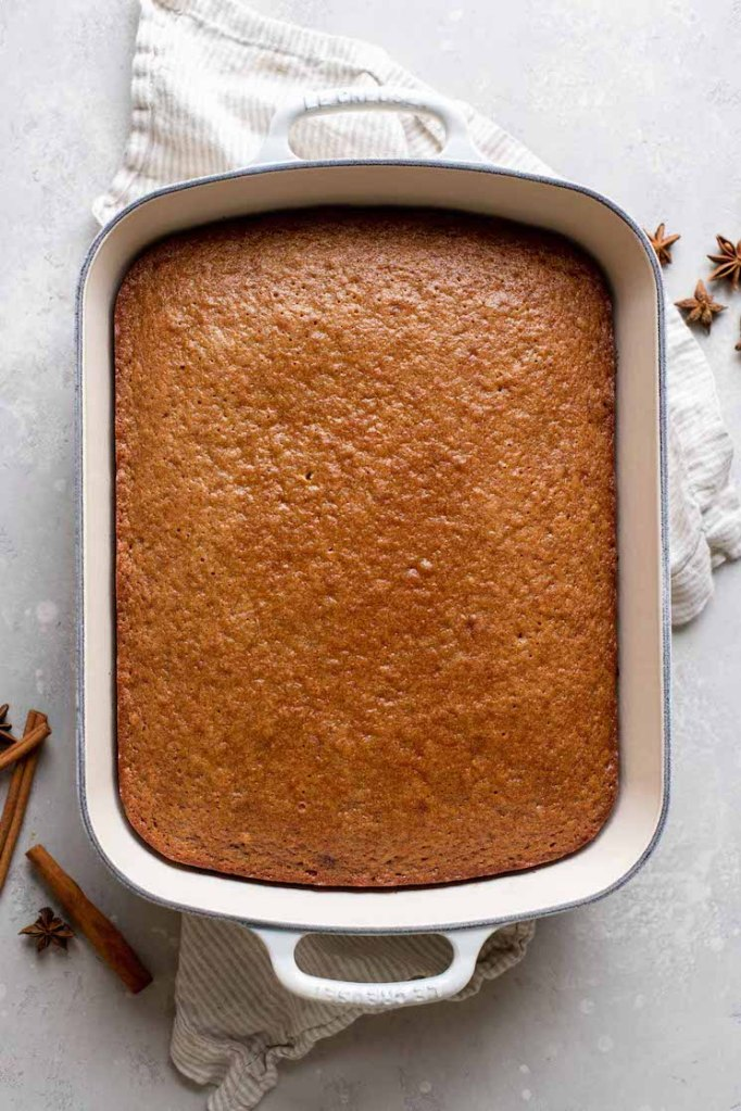 A cake fresh out of the oven that is cooling before being frosted.