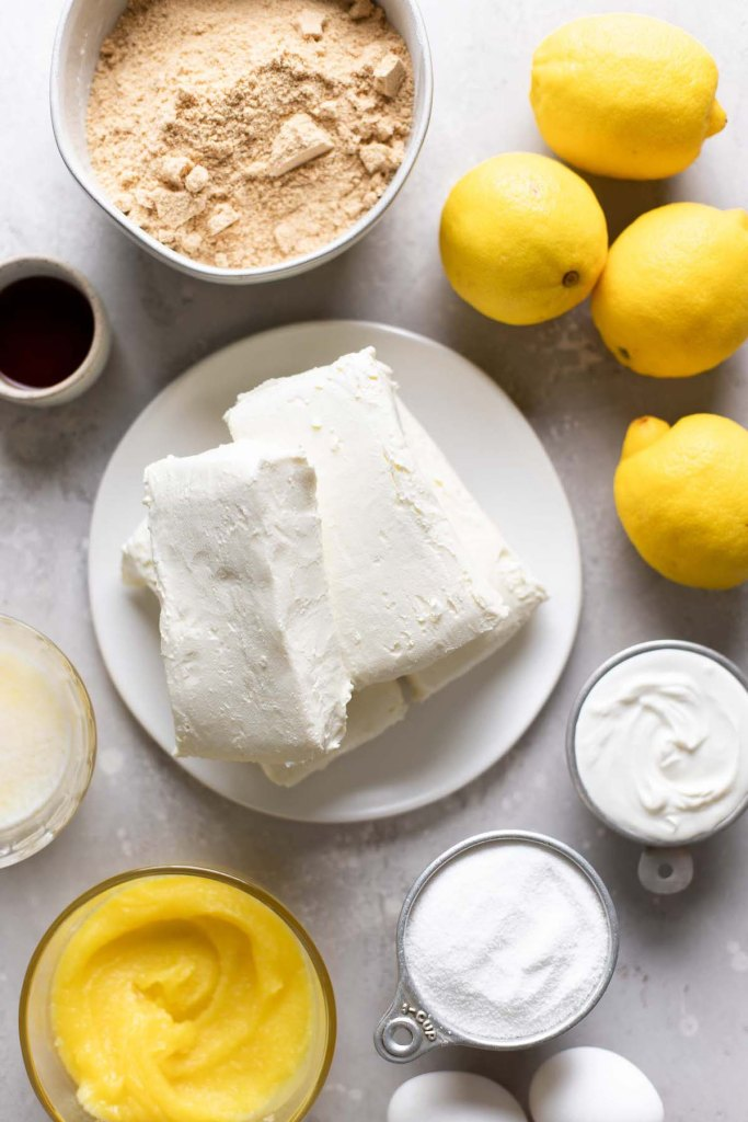 An overhead view of the ingredients needed to make a lemon curd cheesecake.