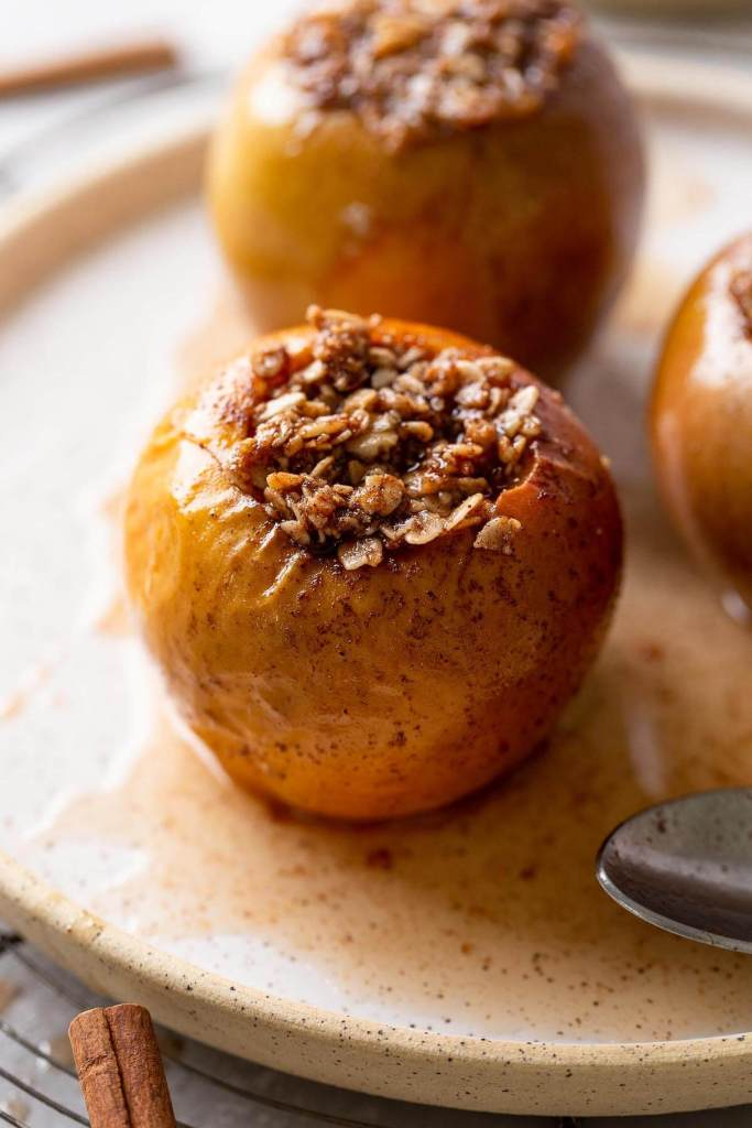 Cinnamon baked apples that have been stuffed with an oat mixture.