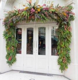 london-white-door-greenery