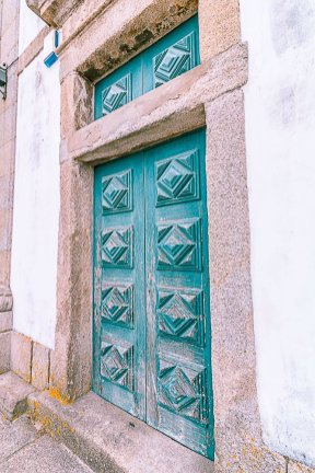 blue door in porto portugal-2