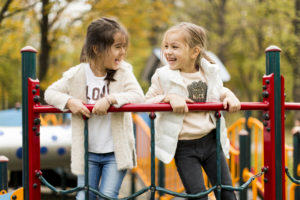 Girls laughing on playground