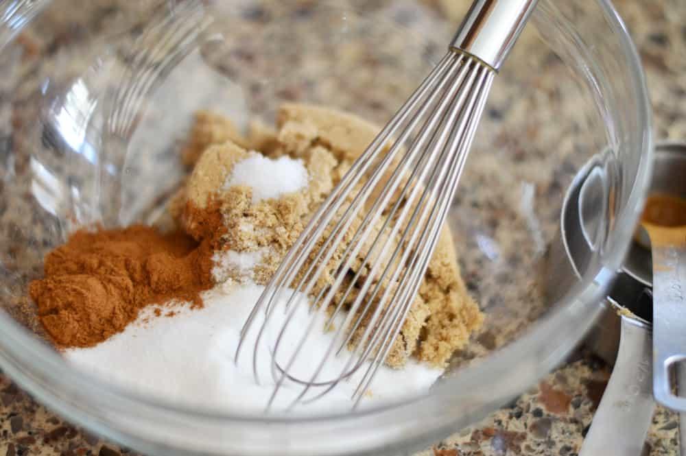 Bowl full of crumb topping ingredients