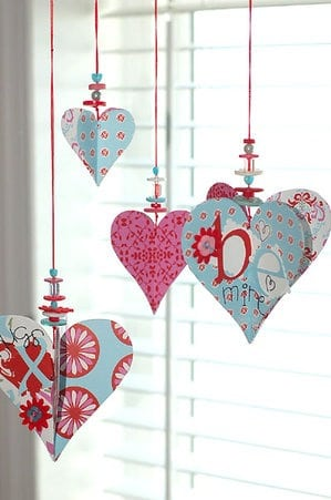 This valentines decoration of paper hearts, beads and buttons is cute for any size house or budget! Also includes more ideas for valentines day decorations to liven up your home decor!