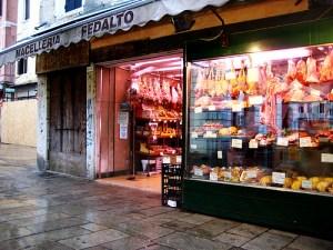 Butcher in the Rialto market, Venice by Nate Gray