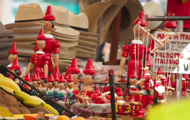 A stall in Piazza Erbe selling Pinocchio marionettes