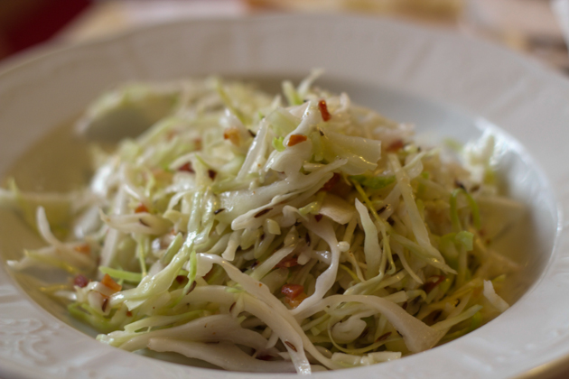 Coleslaw (cabbage dressed with oil, vinegar, caraway seeds and bacon)