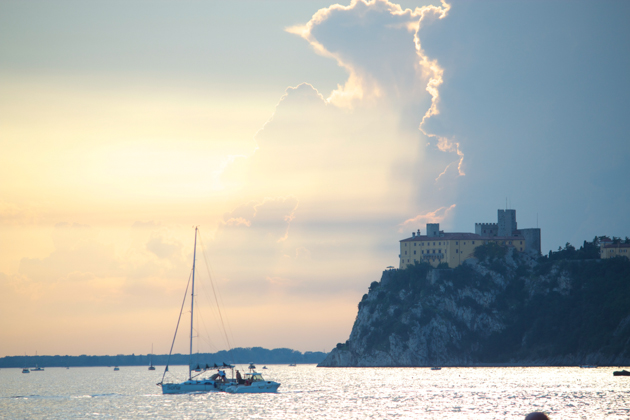 Sunset over the Adriatic Sea and Duino Castle