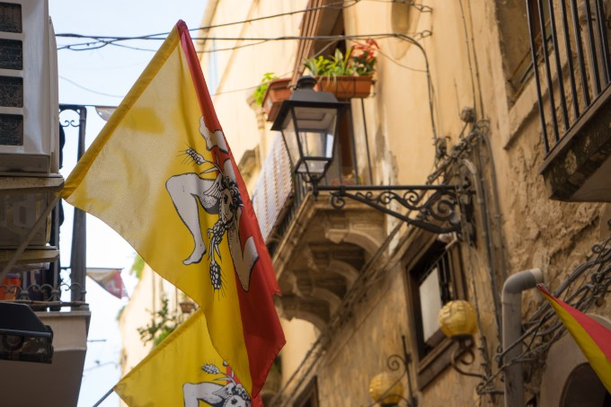 Flags bearing the Trinacria (the symbol of Sicily, Medusa's head with three legs in a triangular shape like the island of Sicily)
