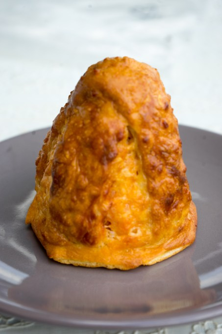Baked arancini (pastry covered rice cones filled with ragu)