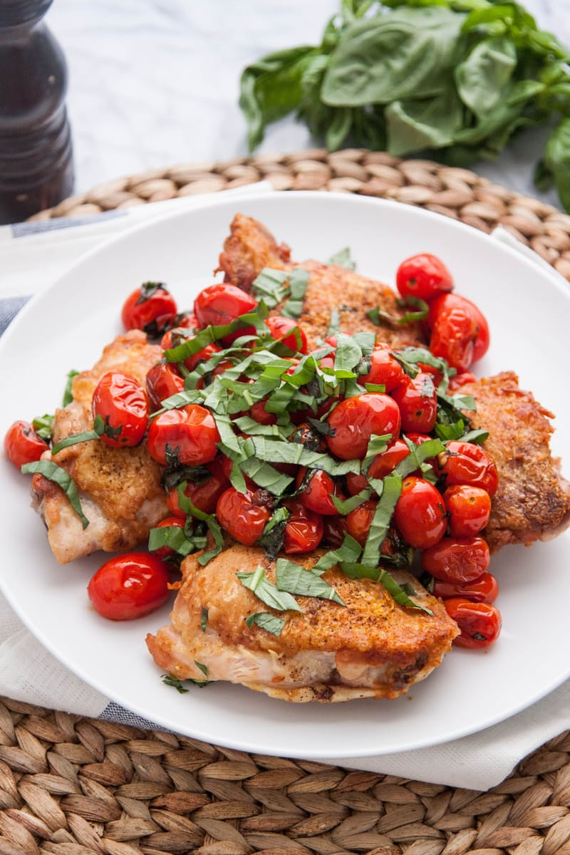 Pan Seared Chicken Thighs with Blistered Tomatoes and Basil