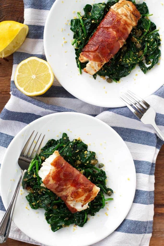 prosciutto wrapped cod with lemon caper spinach