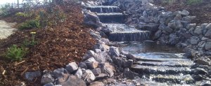 Custom waterfall landscaping calgary