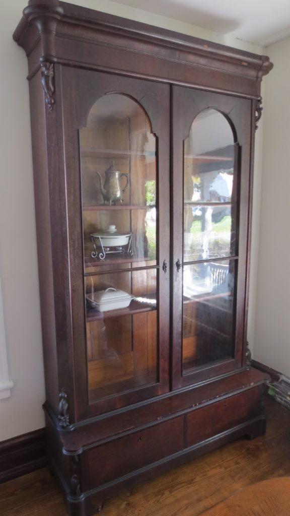 antique empire bookcase dining room