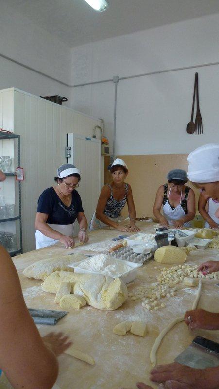 Kneading dough into long sausage shapes
