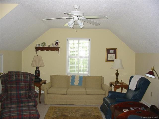 playroom with yellow wall and couch in front of the window