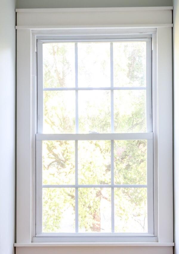 finished DIY craftsman style trim on window