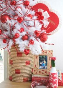 small white Christmas tree in a basket with red Valentine's decor