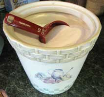 Store measuring cups in your flour and sugar