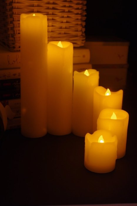 Set of 6 variable sized real wax Flickering Flameless LED Candles, making them ideal for Weddings, Birthdays, Christmas and all celebratory occasions