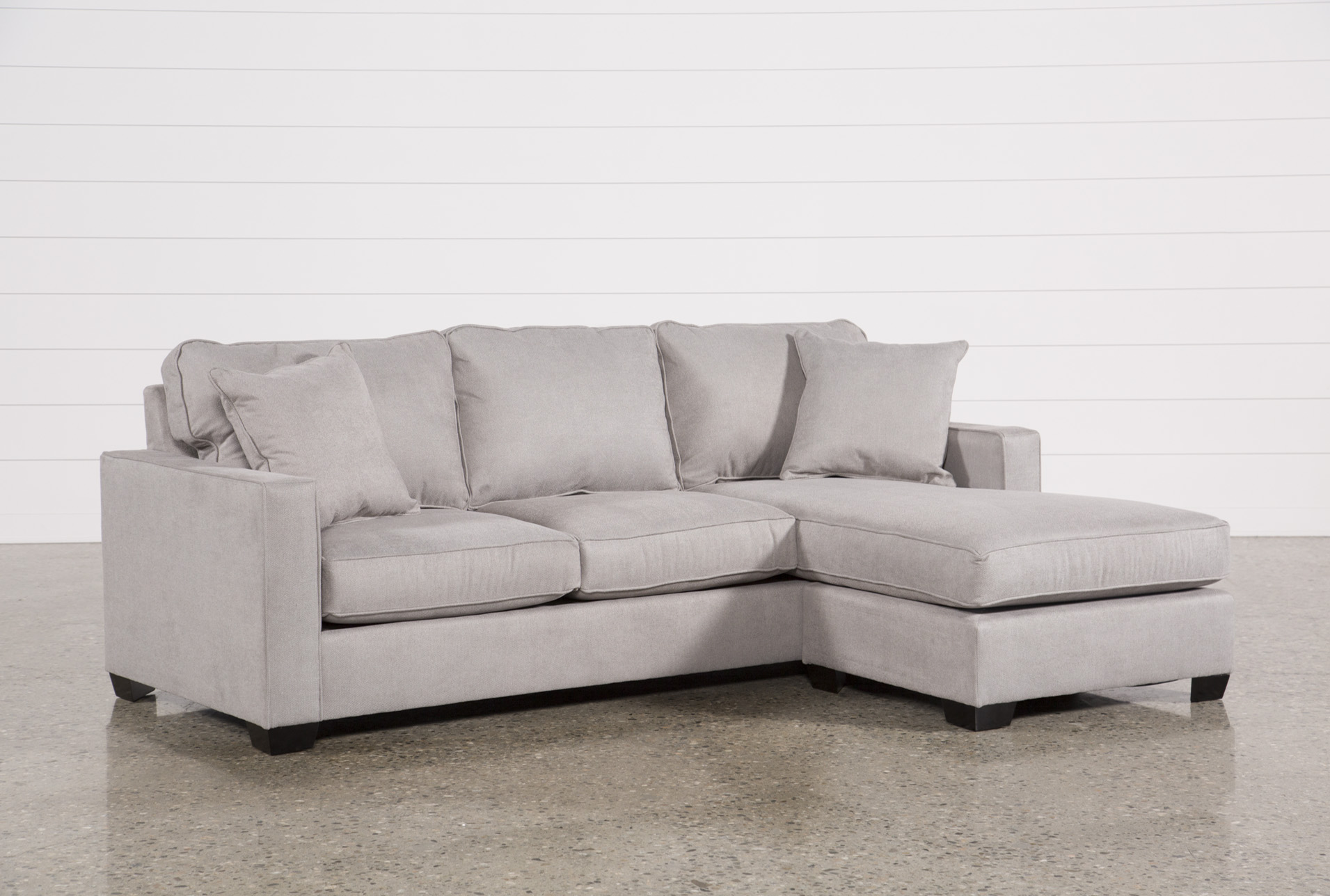 gray sofa with chaise lounge tables that slide under grey sectionals sectional sofas living spaces egan ii cement reversible