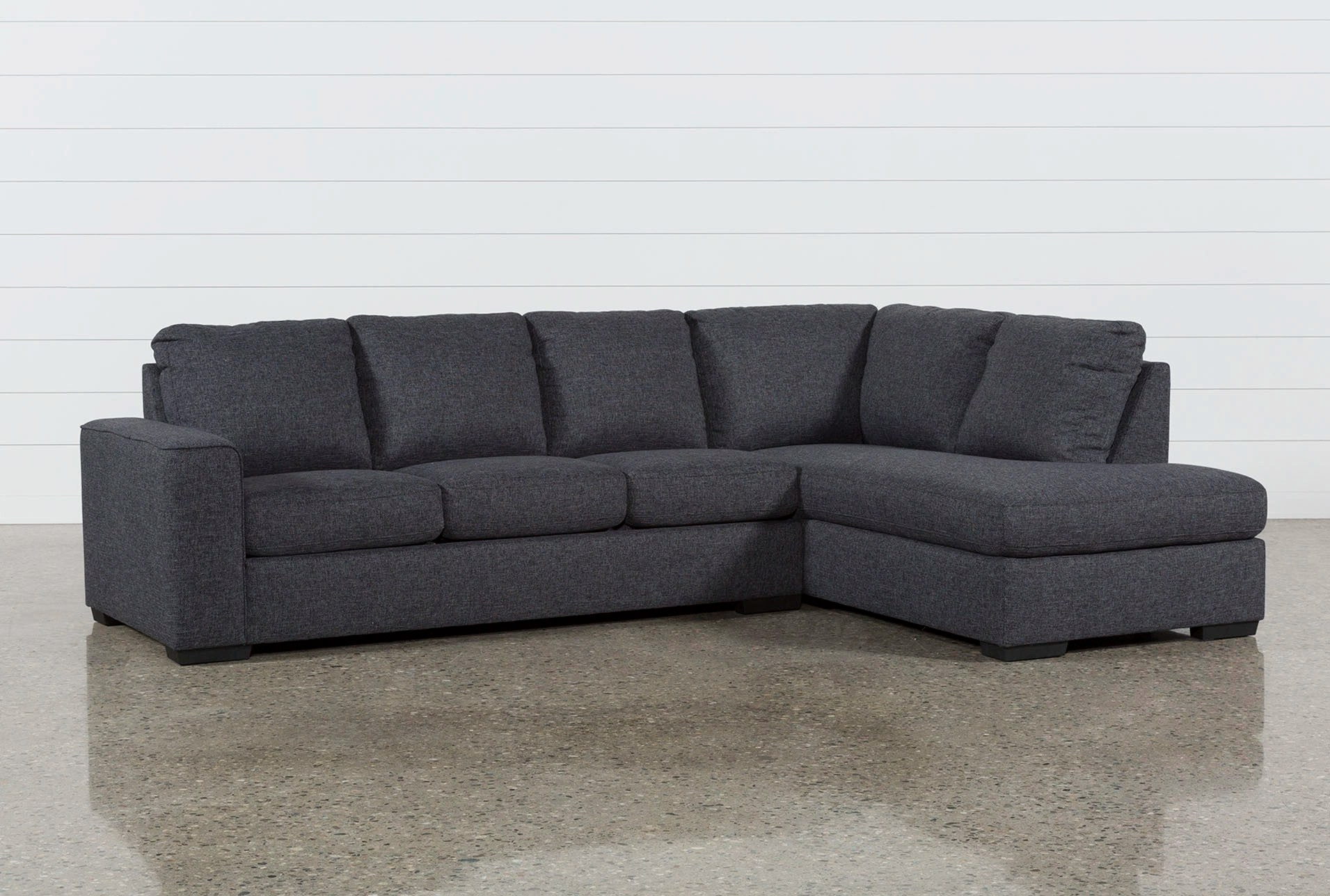 recliner sectional sleeper sofa pierre paulin sofas living spaces lucy dark grey 2 piece w raf chaise