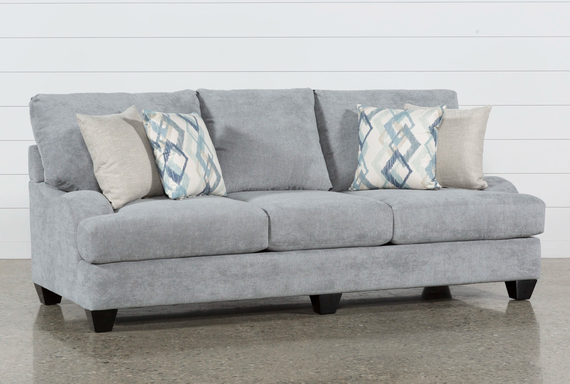 justin ii fabric reclining sectional sofa second hand designer sofas sierra foam living spaces