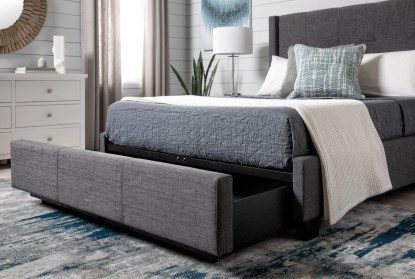 damon charcoal california king upholstered platform bed with strg