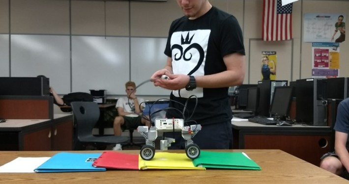 Student with color sensing robot